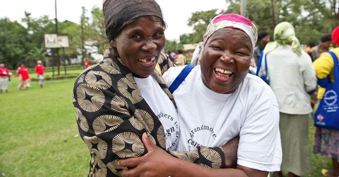 African grandmothers laugh & embrace
